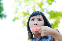 Little Asian girl enjoy her icecream Stock Photos