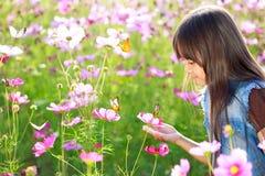 Little asian girl in flower fields. Outdoor royalty free stock photos