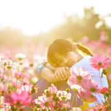 Little asian girl in flower fields Stock Photos