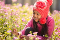 Little asian girl with flower fields Stock Images