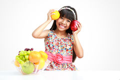 Little asian girl with fruit Stock Photography