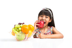 Little asian girl with fruit Stock Image