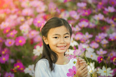 Little asian girl in a garden Royalty Free Stock Photography