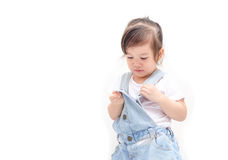 Little asian girl get dressed. Royalty Free Stock Photography