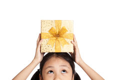 Little asian girl with gift box over her head Royalty Free Stock Image