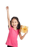 Little asian girl with gift box push her hand up Royalty Free Stock Photography