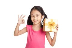 Little asian girl with gift box show OK sign Stock Photography