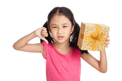 Little asian girl with gift box show thumbs down Stock Image