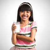 Little asian girl with a glass of milk Stock Photos
