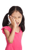 Little asian girl  got toothache put her hand to cheek Royalty Free Stock Images
