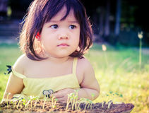 A little asian girl and green sprout Stock Image