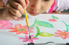 Little asian girl hand paint her watercolor picture Royalty Free Stock Photos
