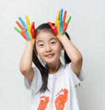 Little Asian girl with hands painted in colorful paints. Little Asian girl with hands painted in colorful paints stock photos