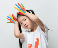 Little Asian girl with hands painted in colorful paints. Little Asian girl with hands painted in colorful paints royalty free stock images