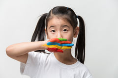 Little Asian girl with hands painted in colorful paints. Royalty Free Stock Photography