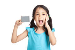 Little asian girl happy with a blank gray card Stock Photos