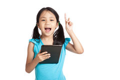 Little asian girl have idea with tablet pc Royalty Free Stock Photo