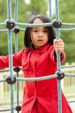 Little Asian girl is having fun in playground Stock Photography
