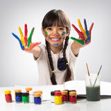 Little asian girl with her hands in the paint Stock Photography