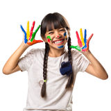 Little asian girl with her hands in the paint Stock Image