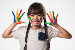 Little asian girl with her hands in the paint Royalty Free Stock Images