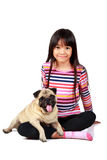 Little asian girl with her little pug. Isolated on white background Royalty Free Stock Image