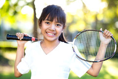 Little asian girl holding a badminton racket Stock Images