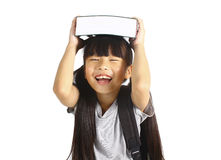 Little asian girl holding the books with her backpack Stock Images