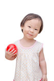Little asian girl holding red ball Stock Photos