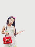 Little asian girl holding a red handbags. Stock Images