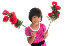 Little asian girl holding a rose Stock Photos