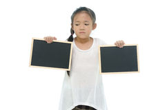 Little asian girl holding two black boards on white background Stock Photo