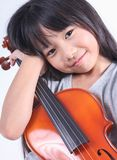 Little asian girl holding the violin isolated on white background, Stock Image