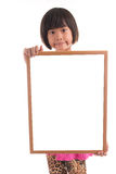 Little asian girl holding white board Royalty Free Stock Images