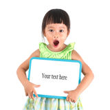 Little asian girl holding whiteboard Royalty Free Stock Images