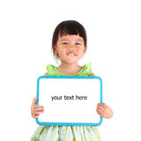 Little asian girl holding whiteboard Royalty Free Stock Photo