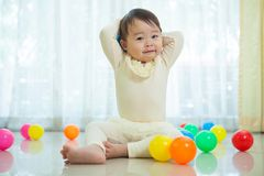 Little asian girl in home Stock Image