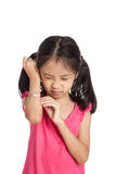 Little asian girl  hurt with bandage on her arm Stock Photo
