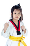 Little asian girl in a kimono with a yellow sash Royalty Free Stock Image