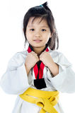 Little asian girl in a kimono with a yellow sash Stock Images