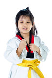 Little asian girl in a kimono with a yellow sash Royalty Free Stock Images