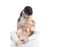 Little asian girl kissing a siberian husky puppy on white backgr Royalty Free Stock Images
