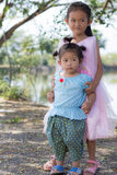 Little asian girl with  lagoon Royalty Free Stock Image