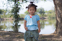 Little asian girl with  lagoon Royalty Free Stock Photography