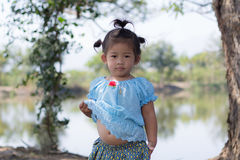 Little asian girl with  lagoon Royalty Free Stock Photo