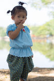 Little asian girl with lagoon Stock Images
