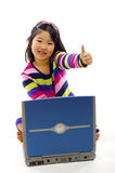 Little Asian Girl - Laptop. Happy little Asian girl working on laptop with thumbs up, isolated over a white bakground stock photo