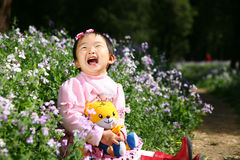 Little asian girl is laughing Stock Image