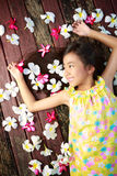 Little asian girl laying on the floor Royalty Free Stock Photos