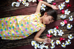 Little asian girl laying on the floor Stock Photography
